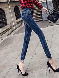Primavera e verão desgaste branco curling desgastado jeans alongamento calças pés rebarba nove pontos magro fino feminino