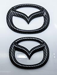 Logo automobilistico logo in oro carbonio in carbonio per mazda
