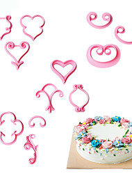Modellazione di zucchero di decorazione della torta di plastica del cuore del merletto dei petali del foro del sugarcraft del fiore di rosa 12pcs