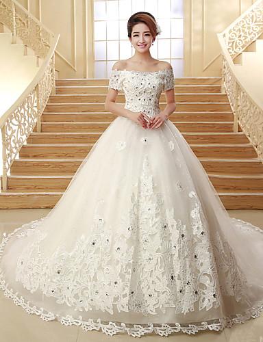 Свадебное платье из тюльпана с повязкой из бисера с бриллиантами